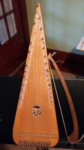 Psaltery and Bow on a Music Stand
