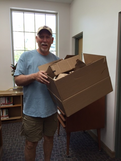 volunteer Carl with box