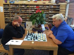 two patrons playing chess in the library